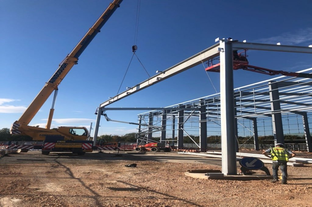 Steel beams being installed for Apollo min